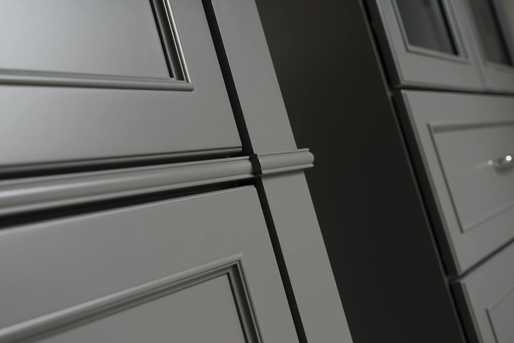 Dark gray painted bathroom vanity cabinets from Dura Supreme Cabinetry.