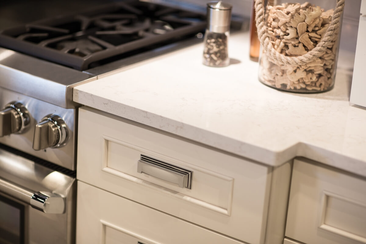 Dura Supreme Cabinetry shown in the Silverton door style with a Classic White finish with Cambria