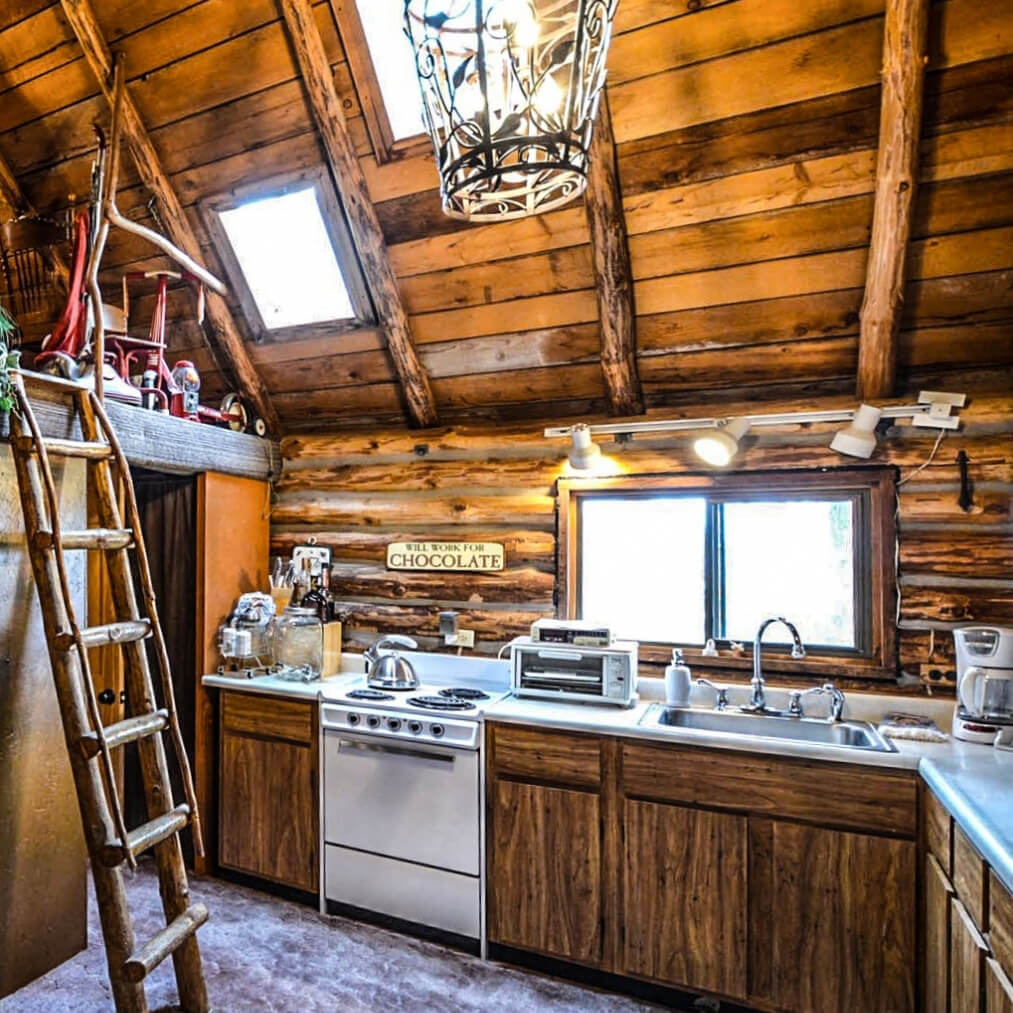 A rustic old-sdtyled kitchen with HIckory cabinets.