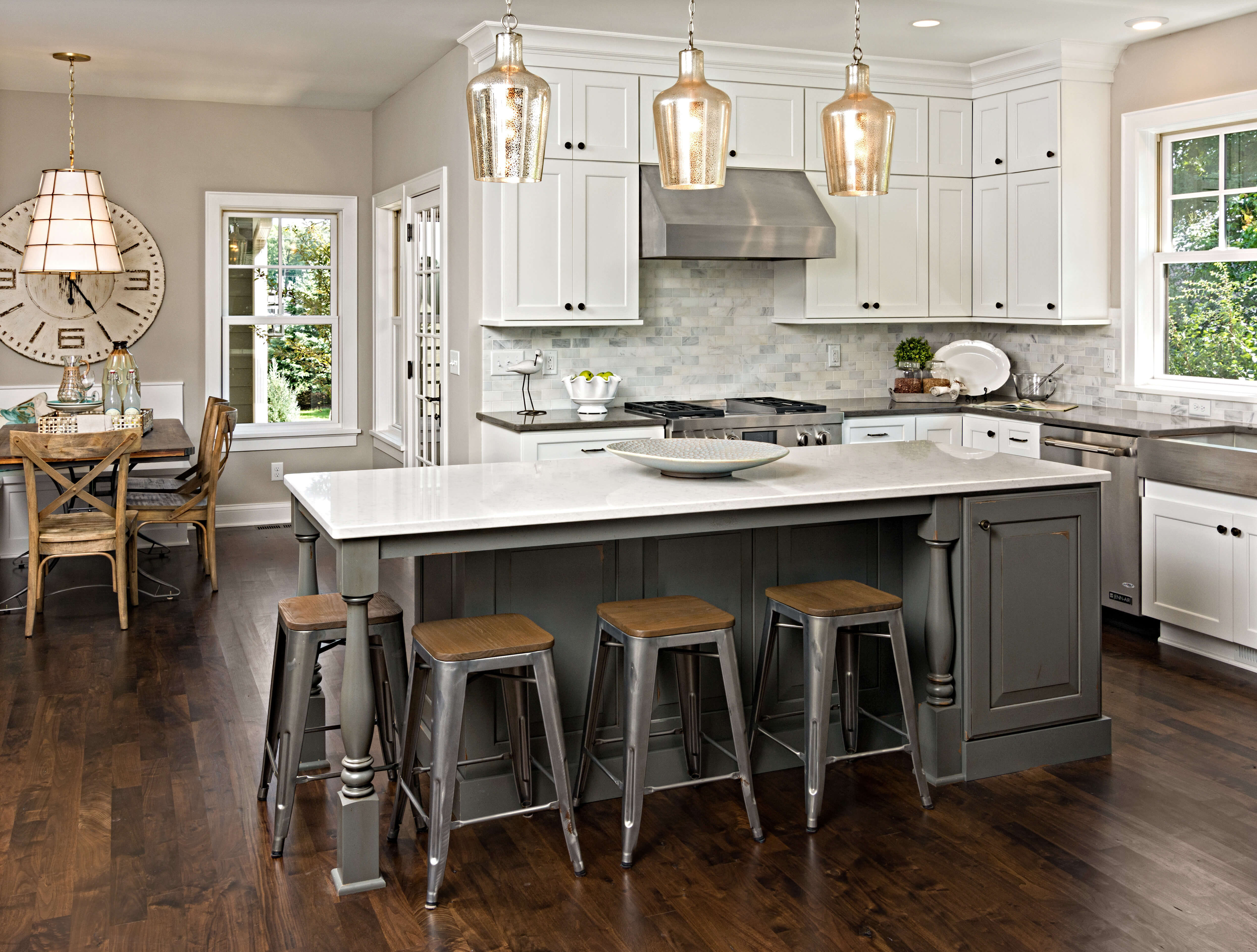 Dura Supreme Cabinetry kitchen featuring a kitchen island with a Heritage Paint finish. Kitchen design by Kristen Peck of Knight Construction Design, Inc., Minnesota.