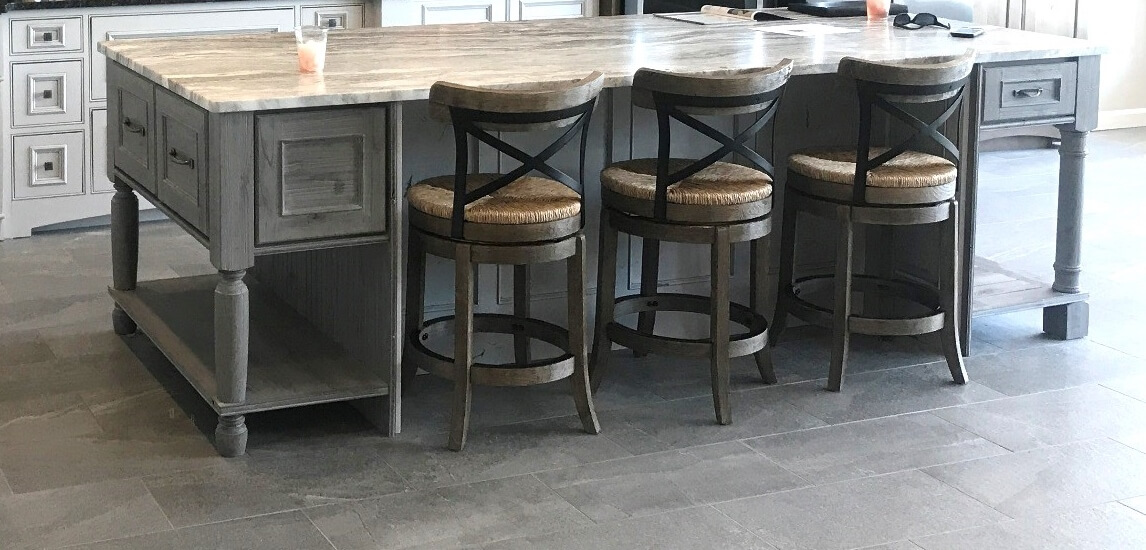 Dura Supreme Cabinetry design by Southern Lumber Supply showcasing two different Island Endcaps by Dura Supreme.