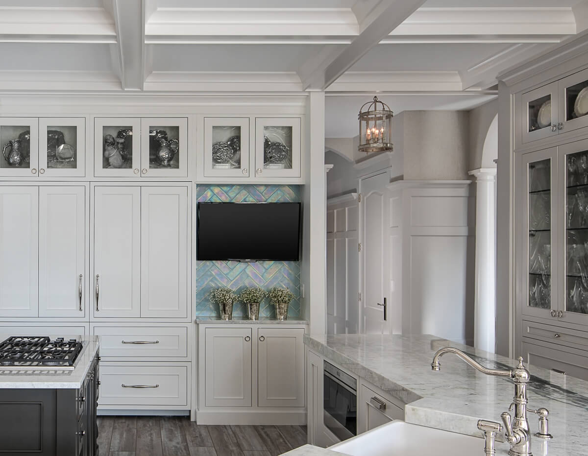 A Dura Supreme kitchen with a cool inspired color palette featuring Dura Supreme's Silverton-Inset door style with a