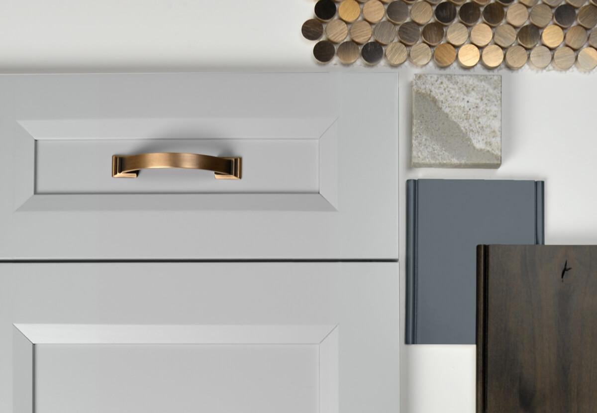 This kitchen design mood board features Dura Supreme Cabinetry's Lauren door style in