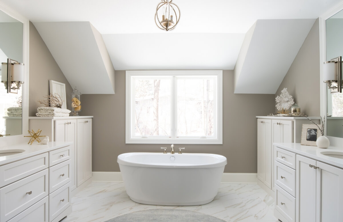 A warm, neutral bathroom featuring Dura Supreme's Kendall Panel door style in