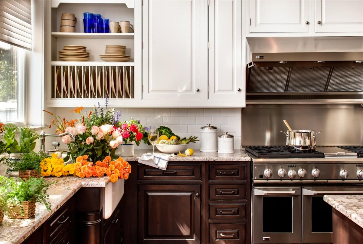 A cozy lake house kitchen design featuring Dura Supreme Cabinetry's Arcadia Classic-Inset door in a combination of