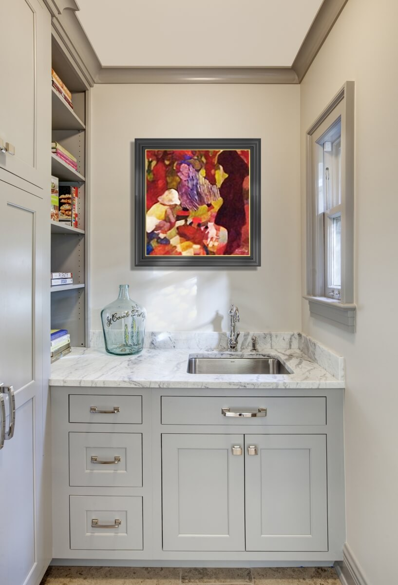 A bright and welcoming butler's pantry and sink nook with light gray painted cabinets and white painted walls.
