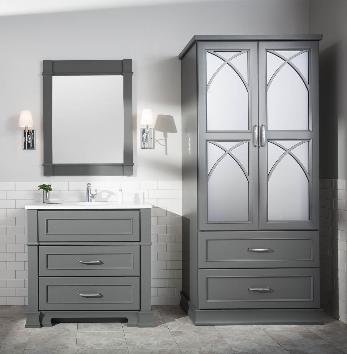Dark gray bathroom vanity and linen cabinet in a modern bathroom design. Remodeled with a timeless look in mind.