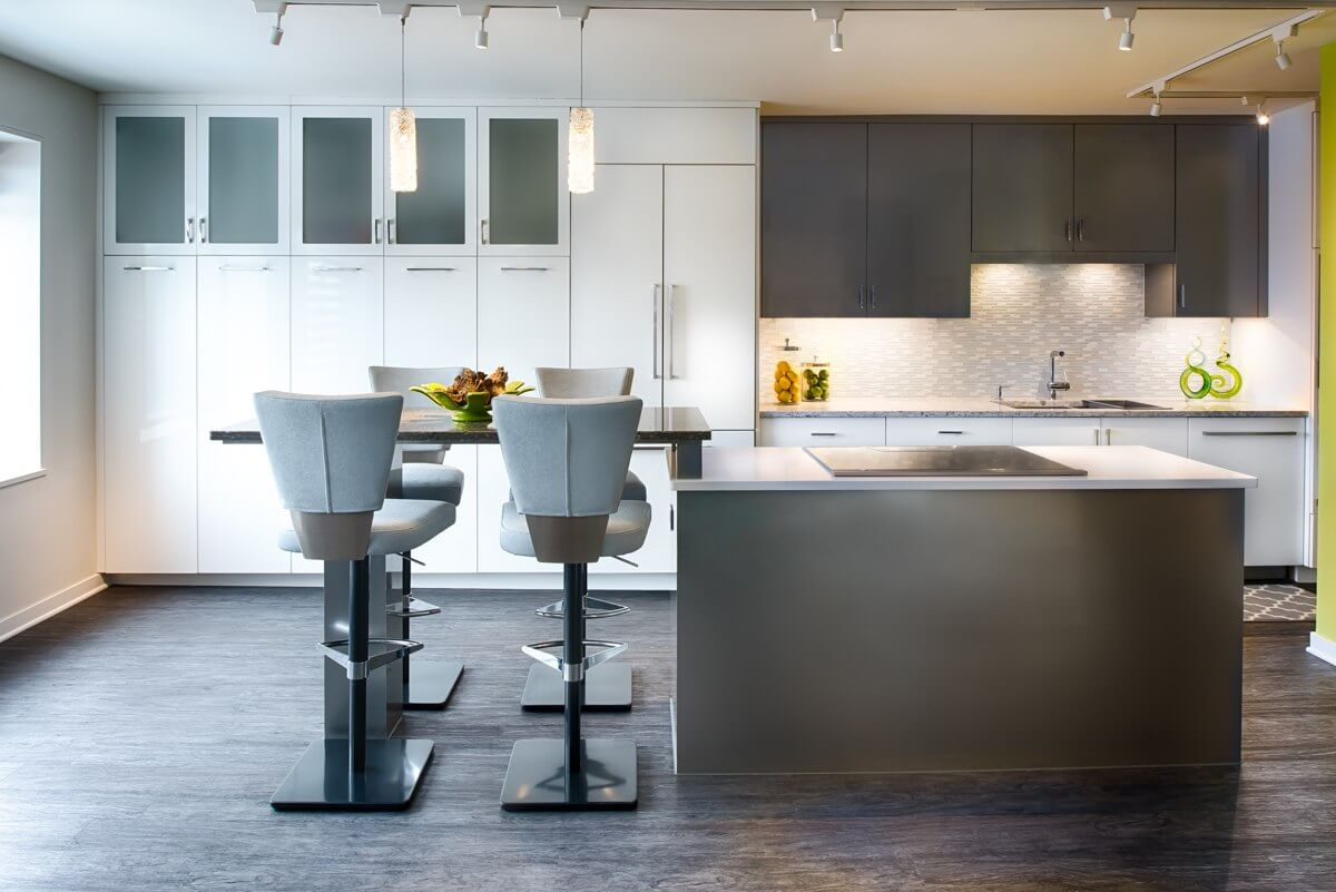 A modern and contemporary styled kitchen with gray and white painted cabinets and vibrant lime green color accents.