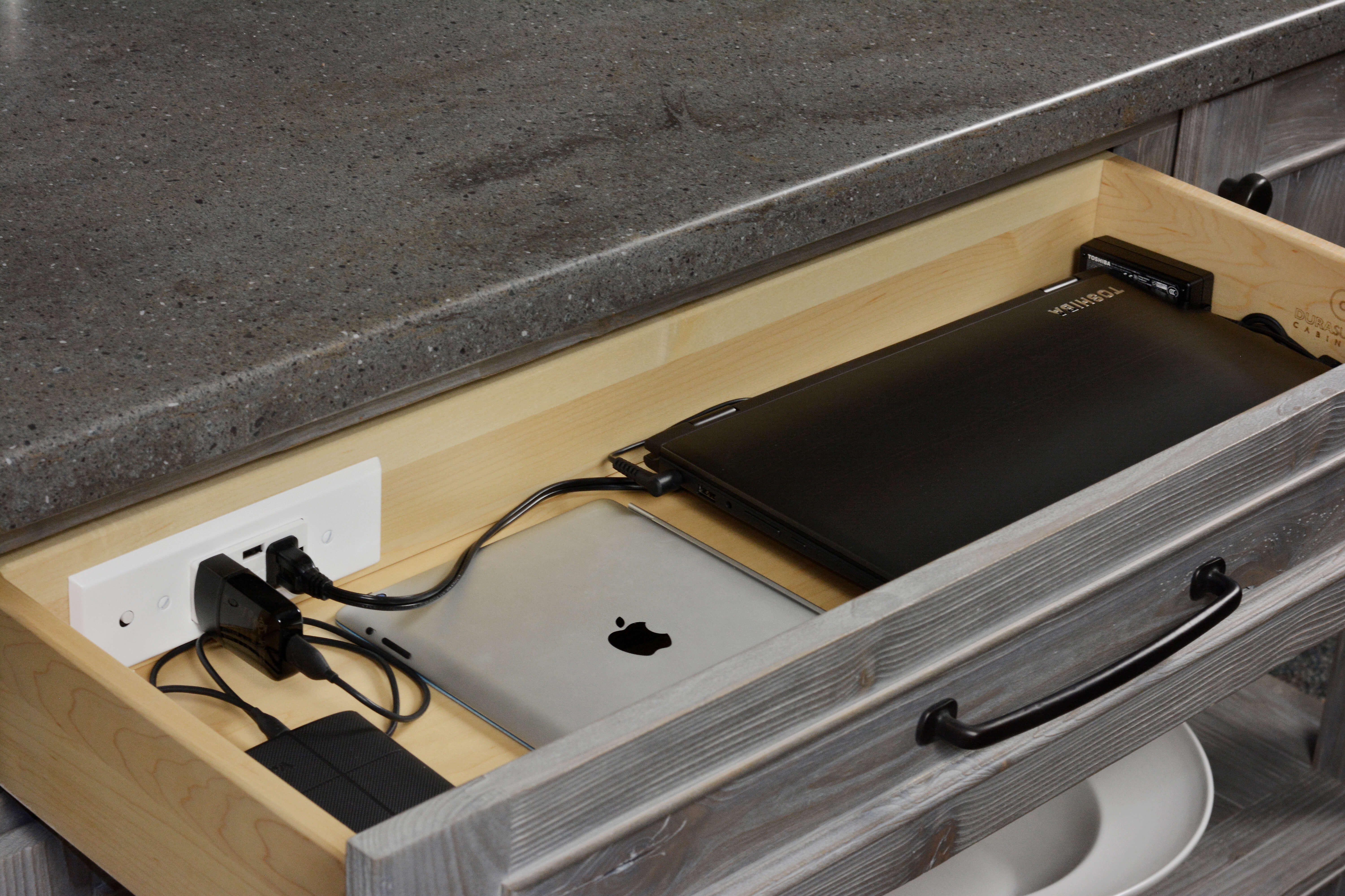 Kitchen and Bath cabinetry storage with power. Drawer Charging Station by Dura Supreme Cabinetry.