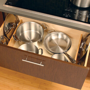 How to organize pot and pan lids with organized kitchen cabinet drawers. Lid Storage Partition storage accessory by Dura Supreme Cabinetry.