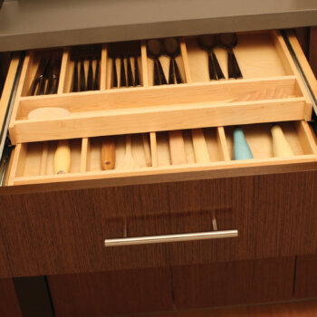 Maximize drawer space with a Two-Tier Wood Cutlery Tray (TTWCT-A) to organize silverware and utensils on two levels within the drawer.