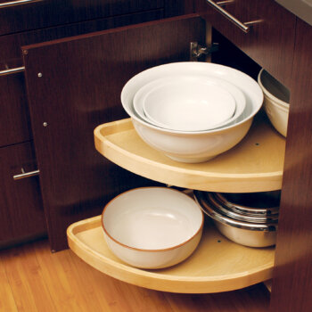 Blind Corner Cabinet storage accessory with accessible pivoting shelves.