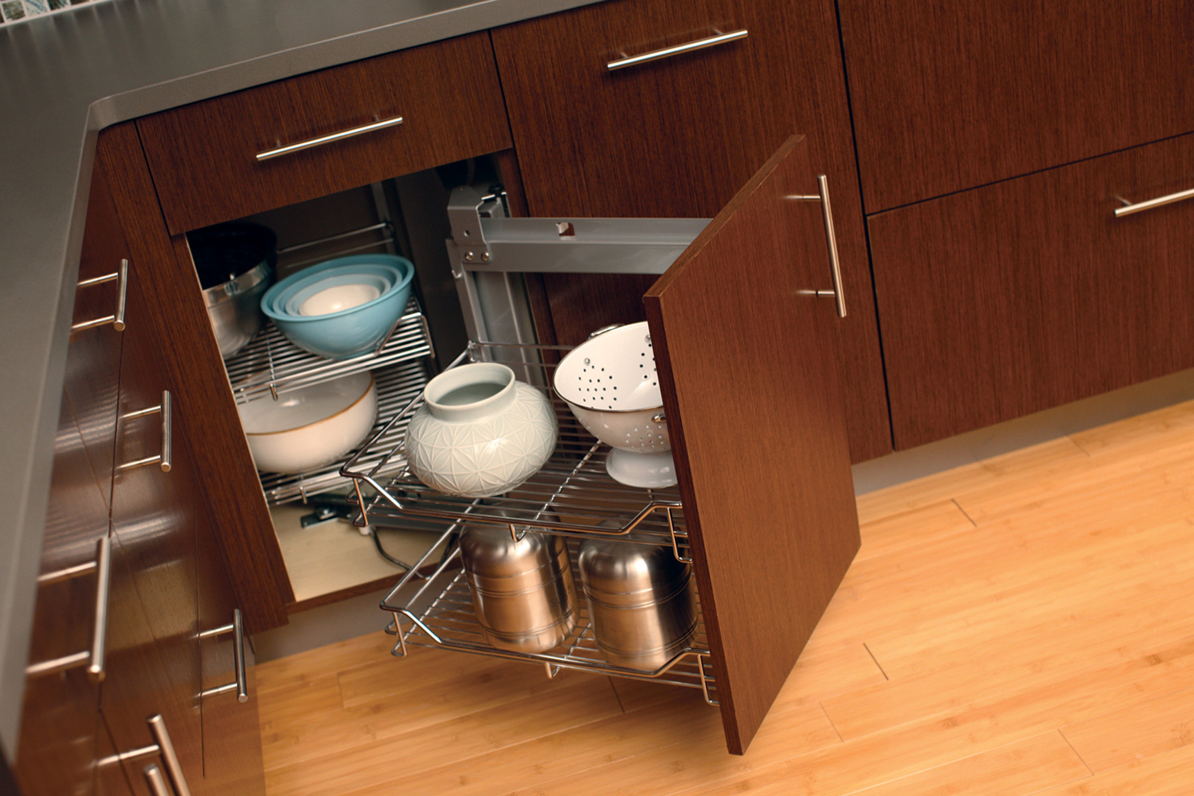 Dura Supreme Swing-out basket storage for corner cabinets.