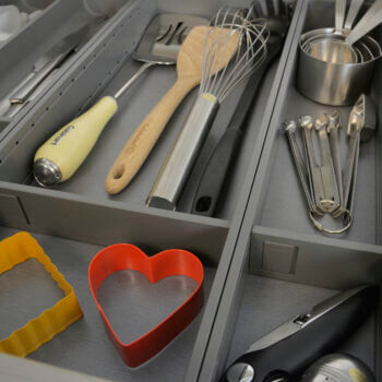 Utensil organizers for stainless steel drawers are available in 2 widths to maximize functionality. This system is easy to adjust. Simply press the release mechanism and reposition and the divider will lock into place.