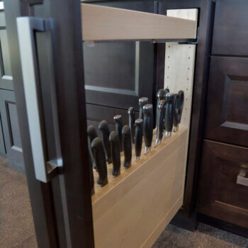 Pull-Out Slotted Knife Block Cabinet from Dura Supreme Cabinetry. Kitchen Cabinet Storage options for cutlery, knives, and utensils.