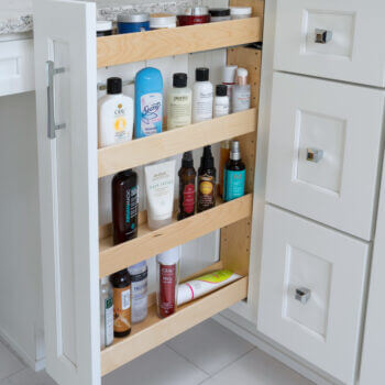 Thin Vanity Pull-Out Storage bathroom cabinet in a vanity by Dura Supreme Cabinetry.