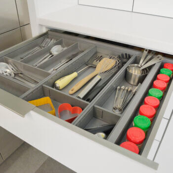 Stainless Steel Cutlery Divider Tray and Utensil Organizers from Dura Supreme Cabinetry. Modern metal kitchen drawer dividers and storage ideas.