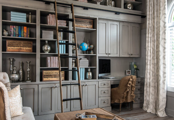 Shabby Chic styled home office and library with floor to ceiling book cases and mobile ladder.