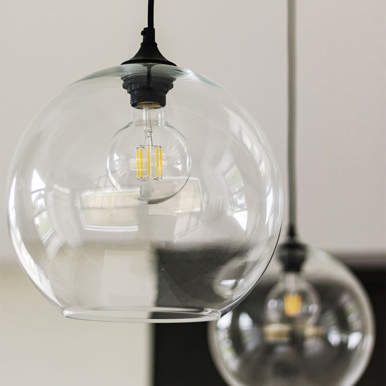 Close up of modern pendant lighting above a ktichen island in a kitchen remodel.
