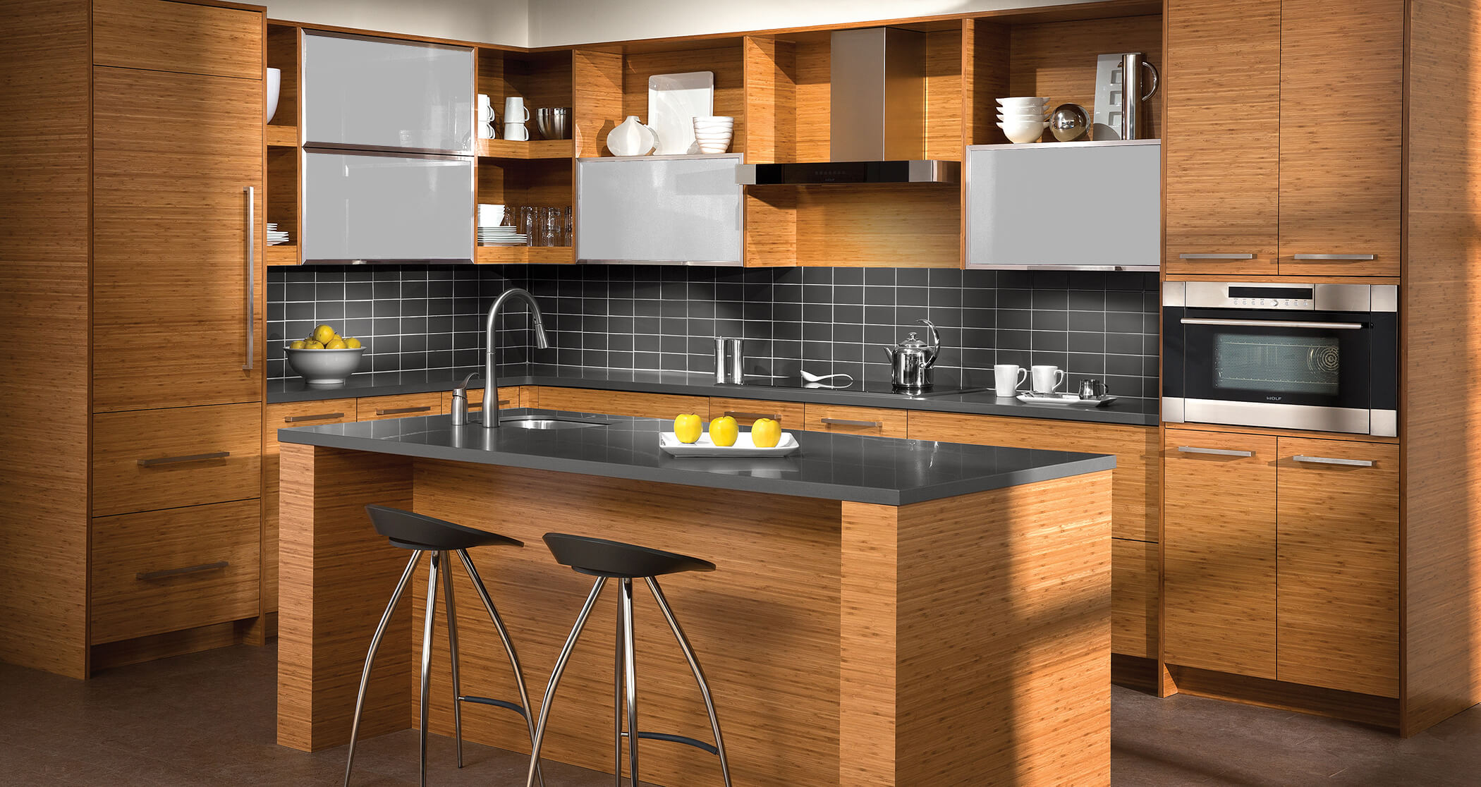 A modern kitchen with bamboo cabinets with a horizontal grain pattern.