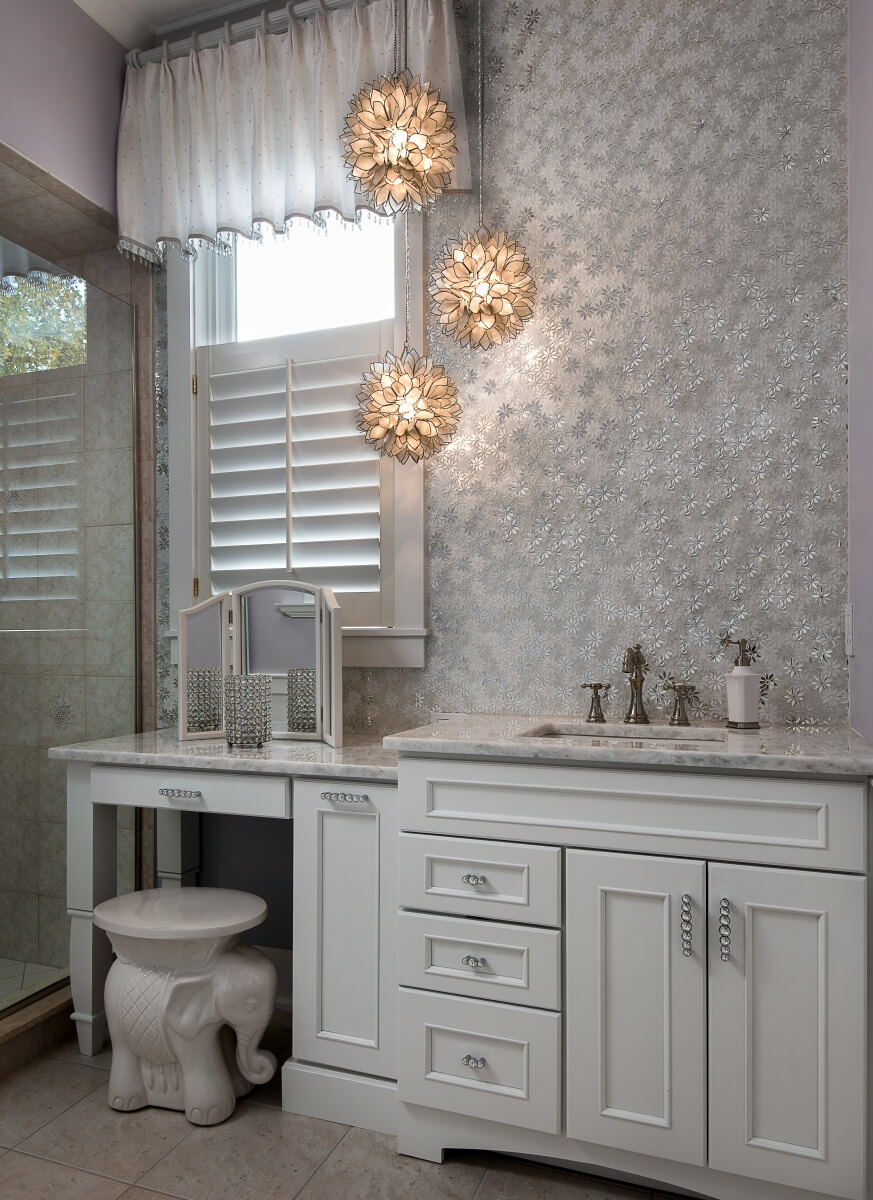 Pale gray painted bathroom vanity cabinets look like a classic off-white color in a kitchen or a bathroom design.