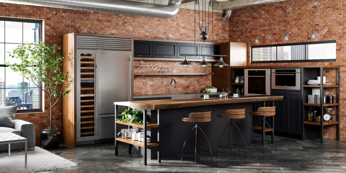 Industrial style urban loft ktichen design with black painted cabinets with warm rich wood finishes and red brick walls. This kitchen remodel features a stunning kitchen island with a wood countertop and lots of industrial features.
