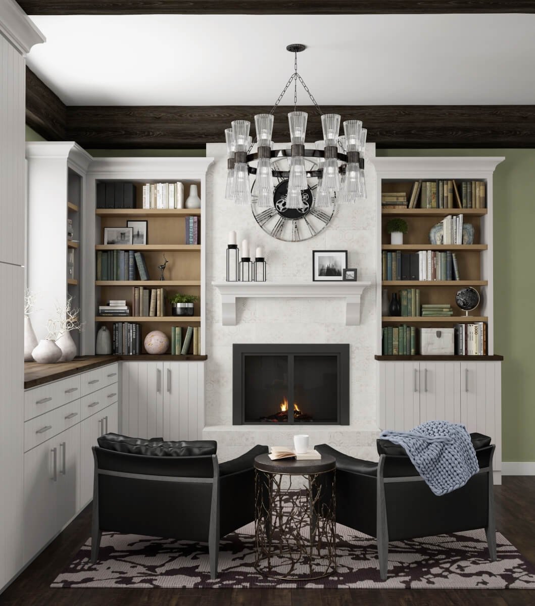 A reading nook and in the kitchen fireplace with living room seating area in an open concept home.