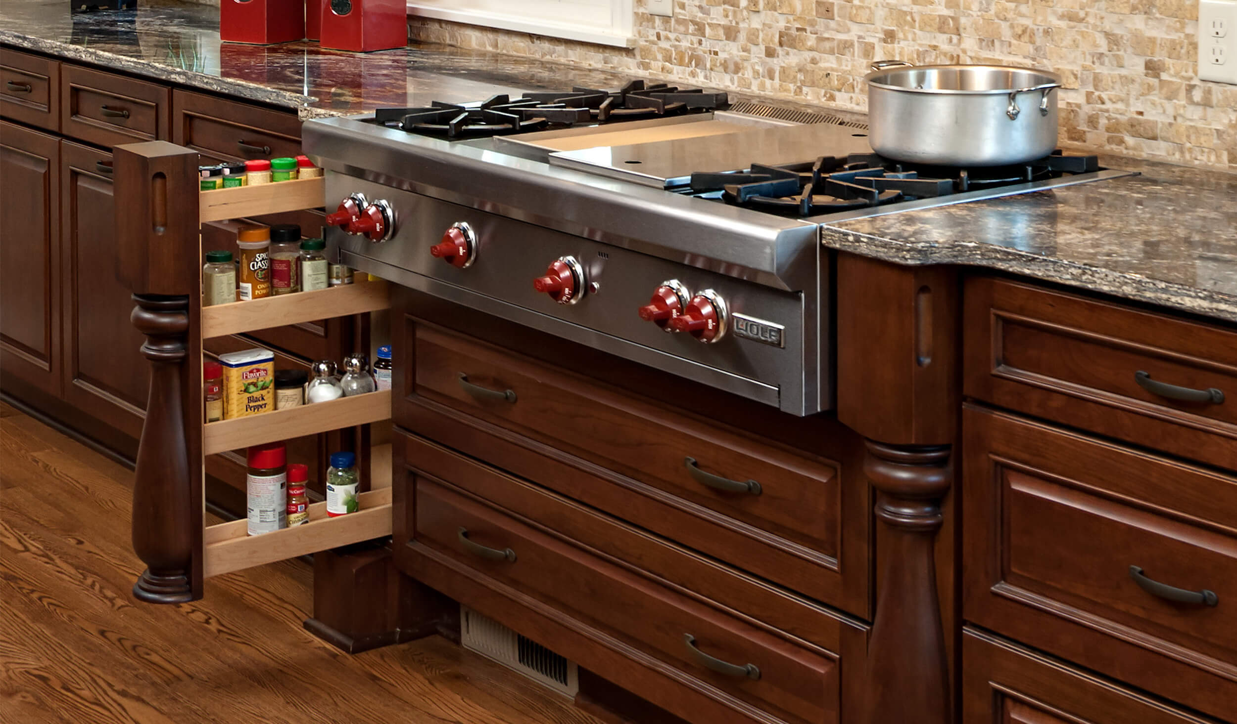 Dura Supreme's Pull-Out Spice Rack hidden behind a decorative turned post. Design by Kristen Peck of Knight Construction Design, Inc., Minnesota.