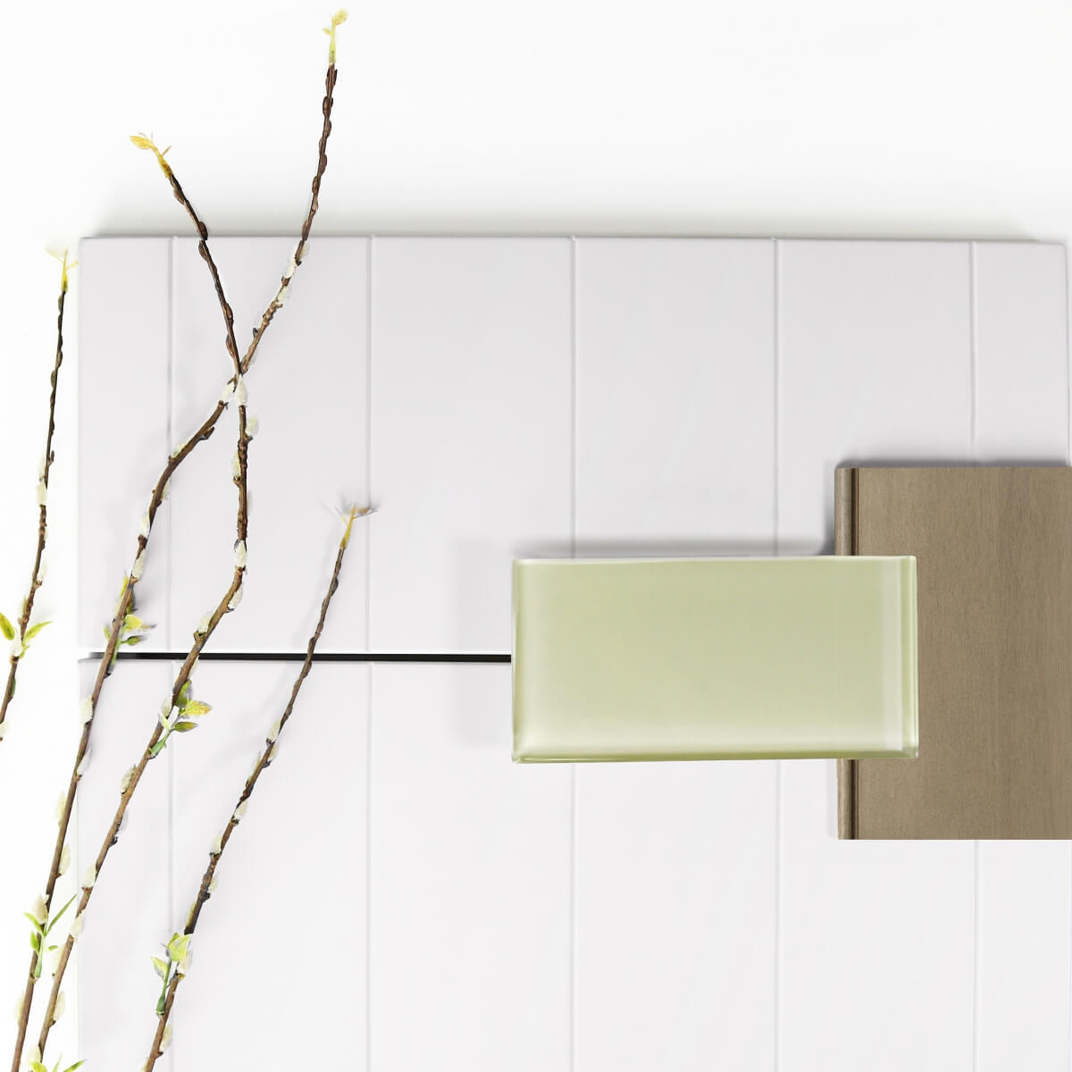 Dura Supreme Cabinetry, Linea door style in Pearl paint, and Maple Cashew chip with pale green glass subway tile