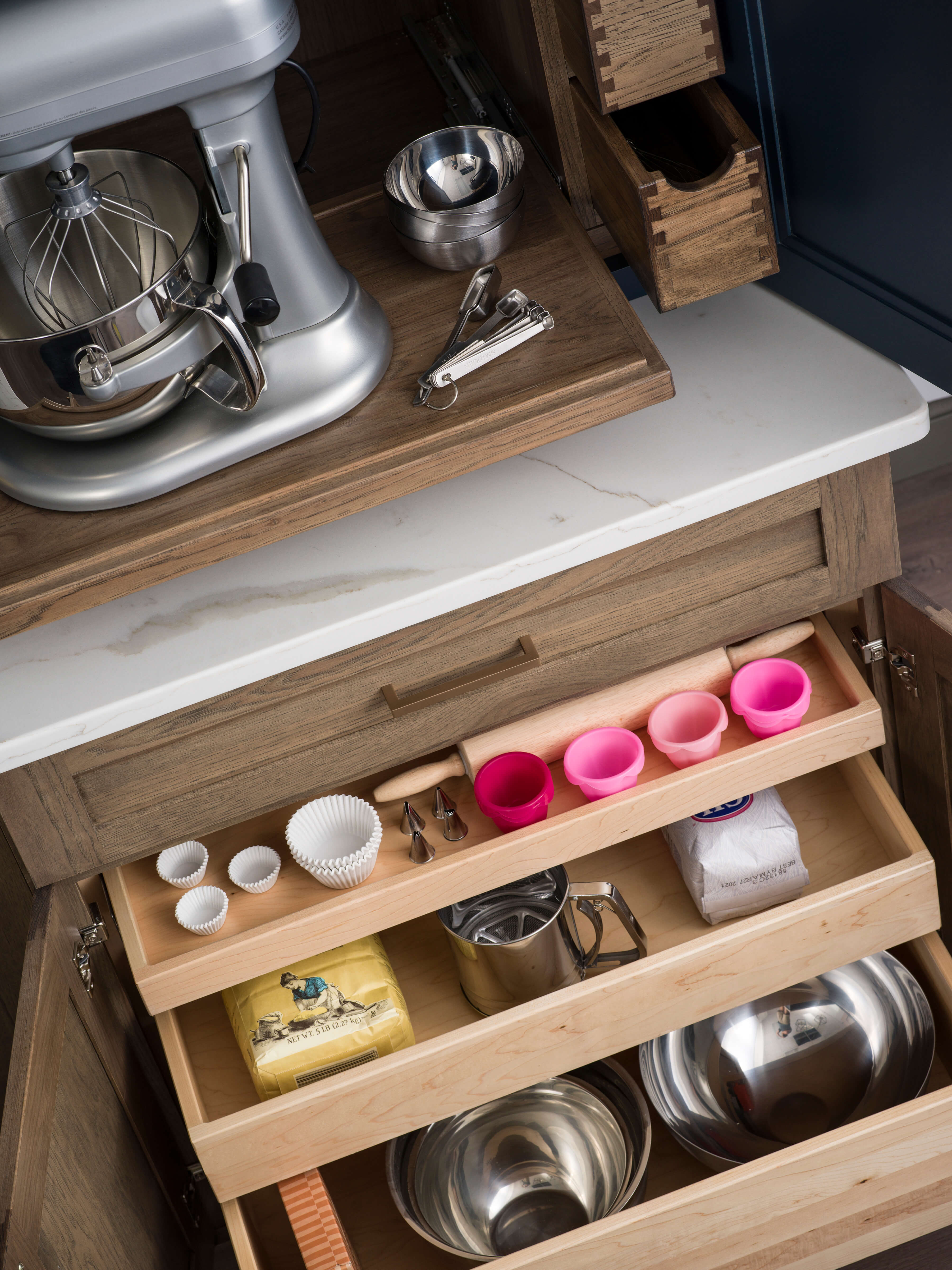 This picture is an excellent example of the variety of roll-out shelf depths that are offered by Dura Supreme Cabinetry.