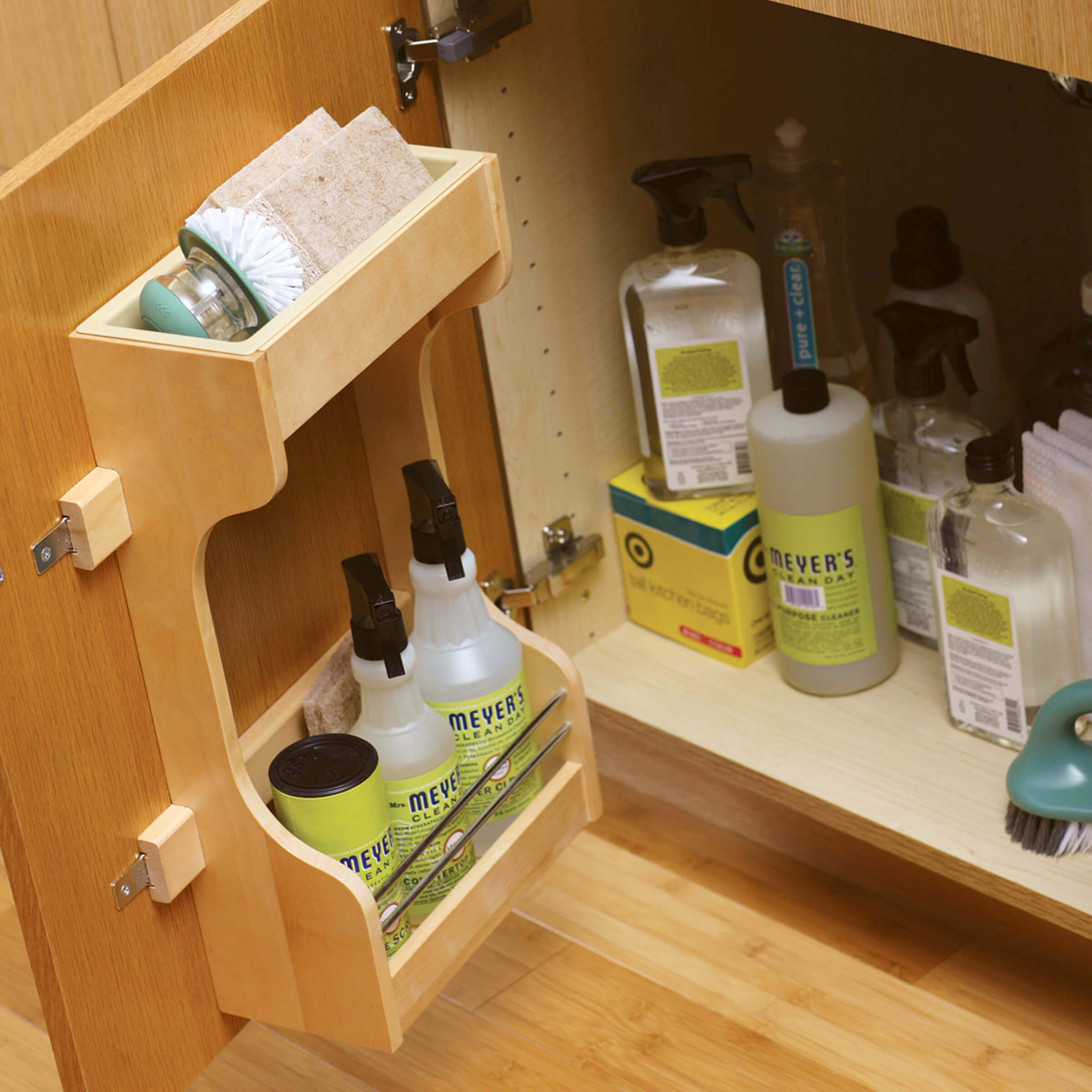 Dura Supreme's convenient storage rack on the cabinet door organizes cleaning supplies and provides a space for you most used products to be close at hand.